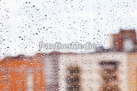 raindrops on home glass window