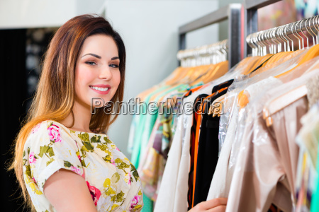 young woman shopping in store or