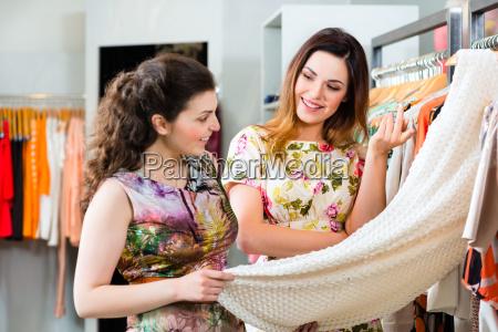 young women shopping in shop or