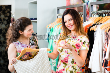 young women shopping in store or
