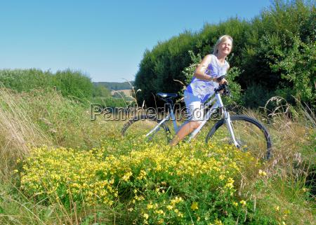 woman making a tour by bike