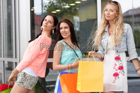 young laughing women shopping in summer