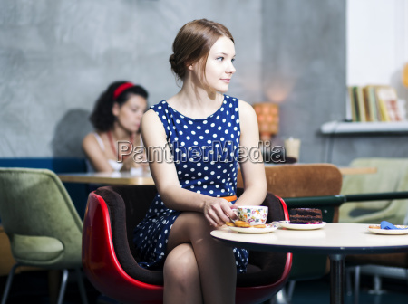 zoomed woman in spotted dress in