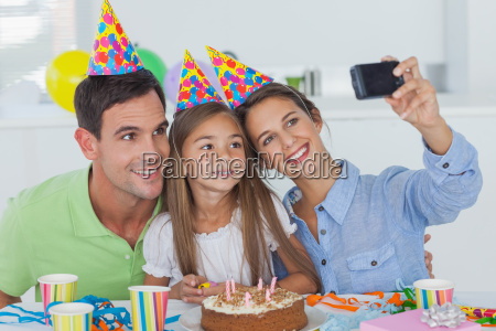 woman taking pictures of her family