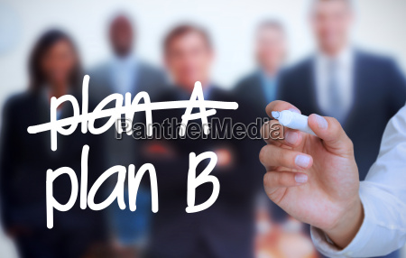 businessman writing plan b with a