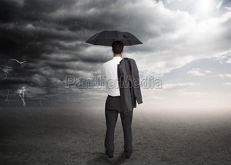 businessman, holding, an, umbrella - 9916954