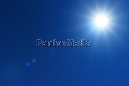 sun with flare on blue sky