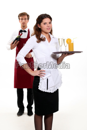 waiter and waitress with a drinks