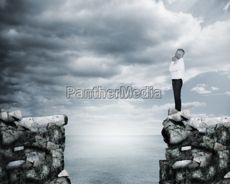 businessman thinking at the edge of