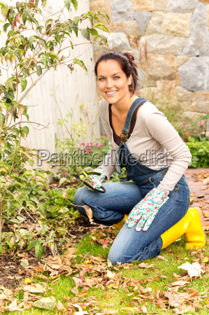 smiling woman gardening yard fall hobby