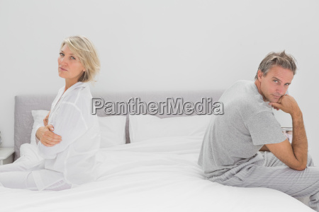 couple sitting on opposite sides of