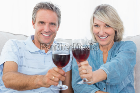 couple toasting to the camera with