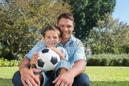 smiling dad and son in a