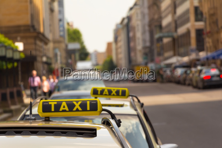 taxi waiting in front of another