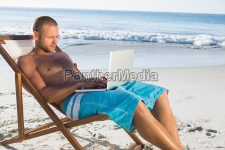 handsome man using his laptop while