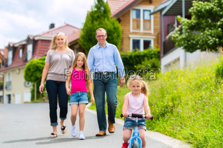 family taking a walk through a
