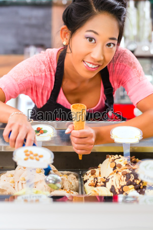 saleswoman in eisladen or ice cream