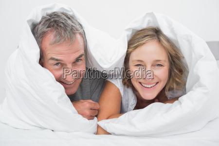 happy middle aged couple under the