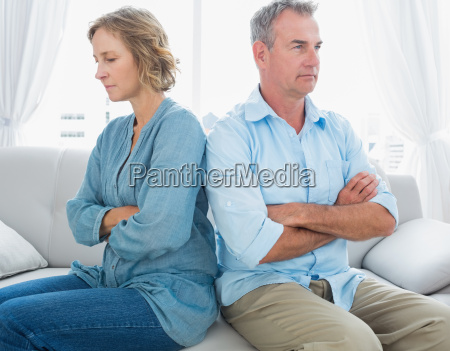 middle aged couple sitting on the