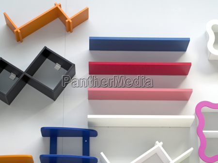 colored wooden shelves attached to the