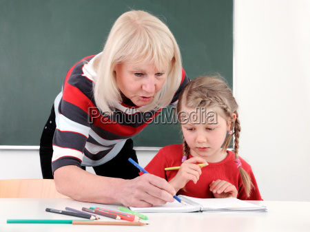 senior teacher helping student