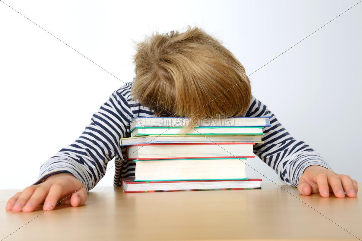 boy, is, sleeping, on, his, books - 10012652