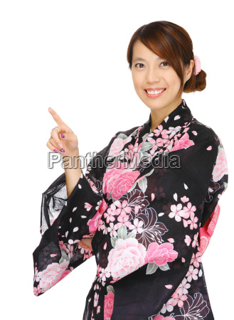 asian woman wearing kimono and pointing