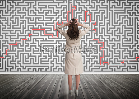 puzzled, businesswoman, looking, at, a, maze - 10024542