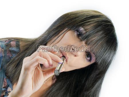 beautiful girl smoking electronic cigarette