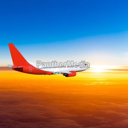 airplane, in, the, sky, at, sunset. - 10026344