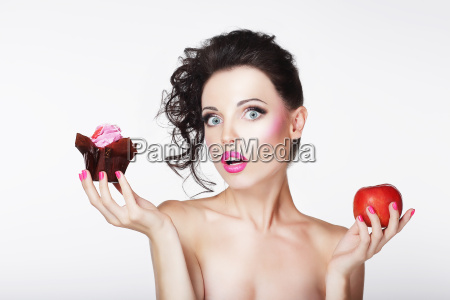 dieting unsure bewildered girl choosing apple