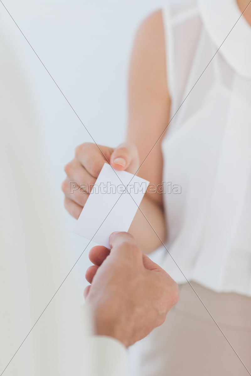 businesswoman, giving, her, business, card - 10040490