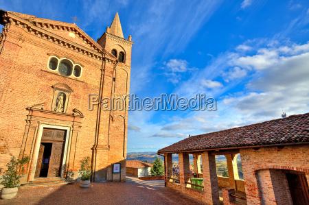 red brick catholic church on small