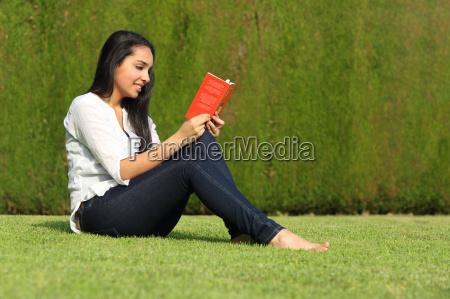 beautiful arab woman reading a book