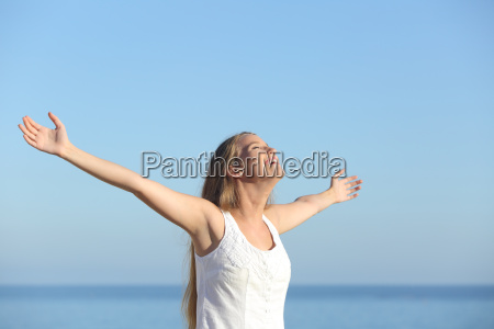 beautiful blonde woman breathing happy with