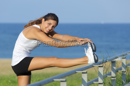 beautiful woman stretching legs looking at