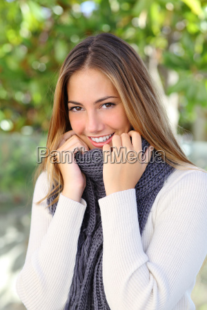 happy woman wrapping with a sweater