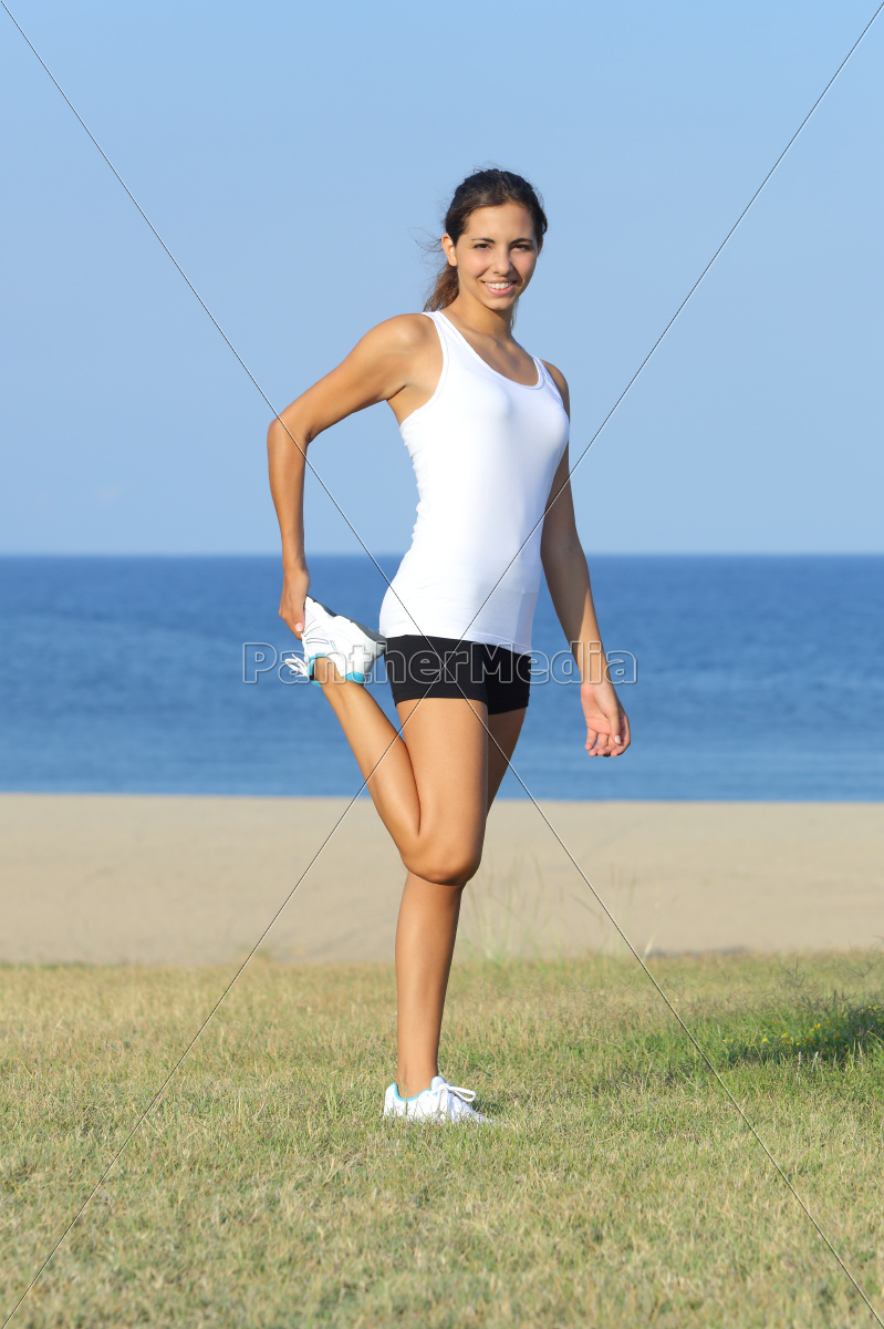 attractive, woman, stretching, legs, outdoor, with - 10043434