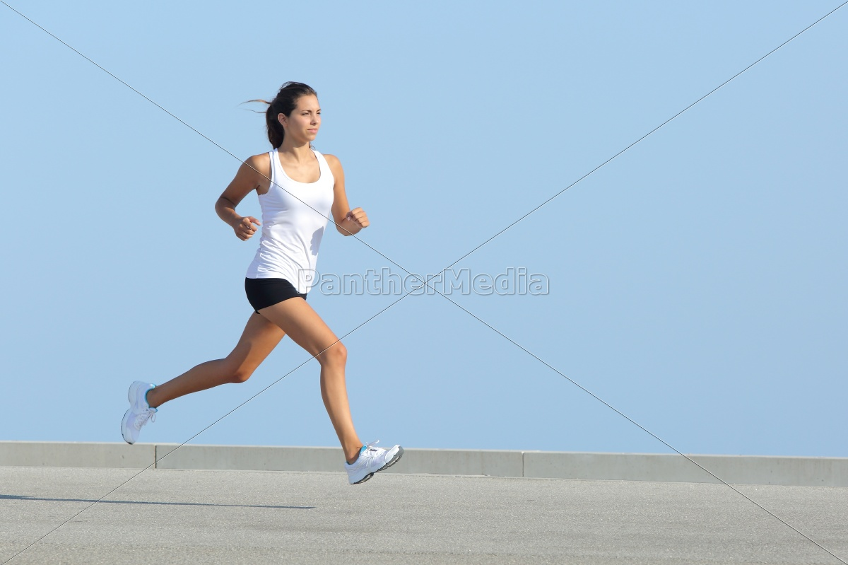 beautiful, sportswoman, running, with, the, sky - 10043512