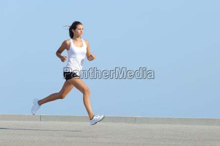 beautiful, sportswoman, running, with, the, sky - 10043512