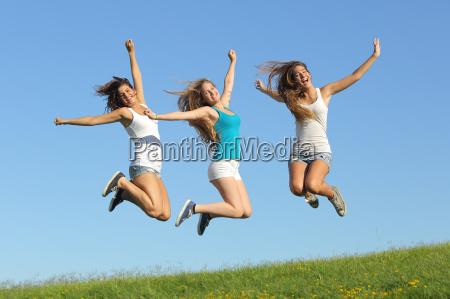 group, of, three, teenager, girls, jumping - 10043676