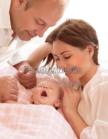newborn, baby, with, parents - 10055970