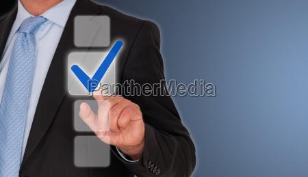 businessman, with, blue, checkbox - 10056104
