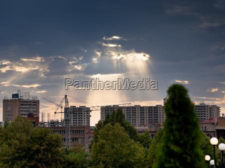 sun rays through clouds illuminate new