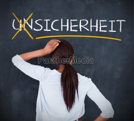 woman looking at a chalkboard with