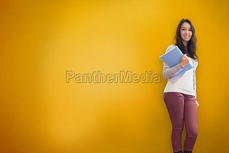 pretty, brunette, holding, notebook, posing - 10077956