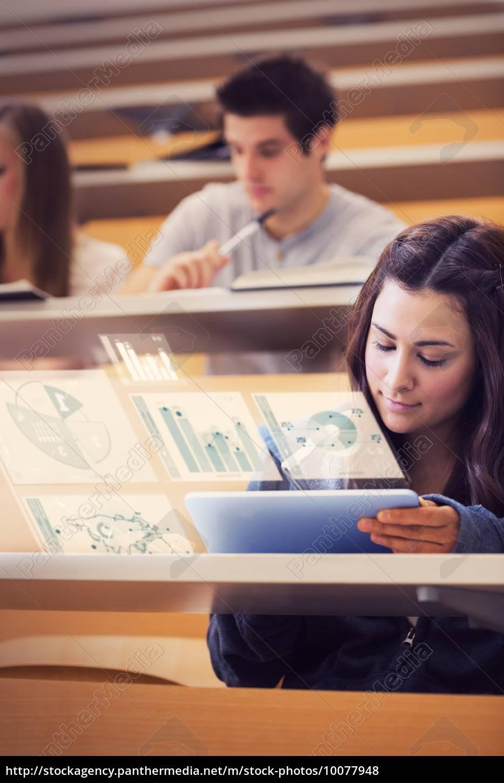 student, analysing, graphs, on, her, digital - 10077948
