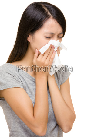 asian woman sneezing