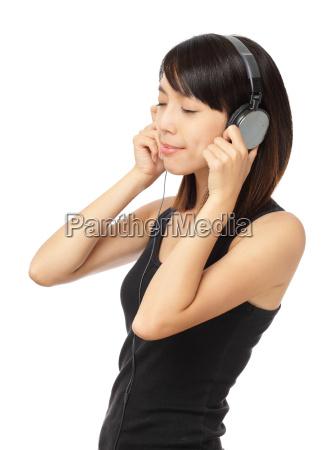asian woman enjoy the music