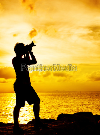silhouette, of, photographer, with, at, sunset - 10094210